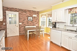 Beautiful large kitchen with brick face wall and door to brand new large TREX Deck