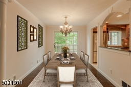 Elegant Dining Room with Sliders to the airy deck.