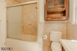 Master bath with tub shower and pretty marble vanity.
