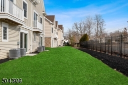 Common area perfect for your pet .  Fenced in- professionally and meticulously  landscaped and newly mulched overlook  this from your  first floor office slider.