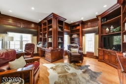 First floor Office with hardwood floor, custom built-in book shelves and cabinetry.