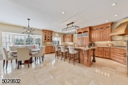"Open concept custom kitchen with Bertch cabinetry, granite countertops, center island breakfast bar with butcher block, Sub-zero refrigerator/freezer, Dacor 36"" 5 burner gas cooktop & vented hood, Decor double oven & 2 Miele dishwashers."