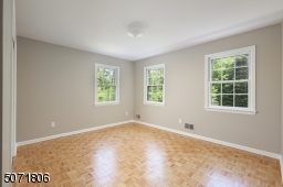 Bedroom with Parkay floors and decorative molding.