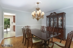 Dining Room with parkay floors and decorative.