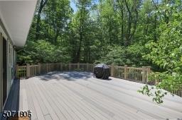 Large deck overlooks the beautiful yard.
