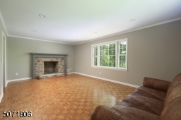 Parkay floors, decorative molding, picture window and fireplace.