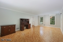 Parkay floors, decorative molding and picture window.