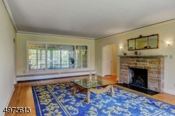 Double Picture Windows in the Living Room with Gas Fire Place overlooking 3 Season Florida Room.  Gold Leafed Crown Molding. Hardwood Floors through out 1st floor.