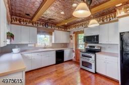 Wood/Tin Ceiling.  New Windows, Floor and Wood Floor.