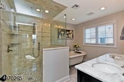 Soaking Sub, Quartz vanity w/double sinks, Large shower with Bench