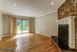 Wood floor refinished, sliding doors to patio, recessed lighting.