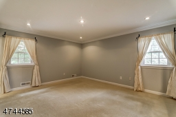 Recessed lighting.  Walk-in closet plus additional closet. OF NOTE: carpeting has been removed, wood floors finished.