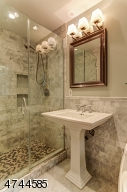 Attractively remodeled featuring  large marble shower and pedestal sink.  OF NOTE: medicine cabinet is being replaced.