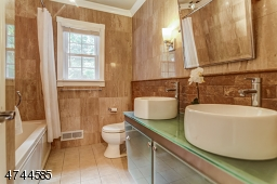 Attractively remodeled - jetted tub, newer vanity, sinks. Laundry closet. (Vanity doors have been replaced)