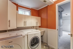 Full size washer, dryer.  Cabinet space and laundry sink.