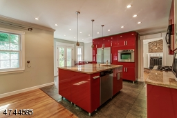 Large Island - all granite counter tops, ample recessed lighting plus accent lighting over island.