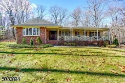 4X sided brick home with an open porch.