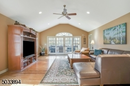 This room is a WOW! soaring ceilings, huge windows that overlook the backyard.