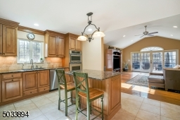 Maple cabinetry, top of the line Kitchen Aid appliances and granite counter tops.