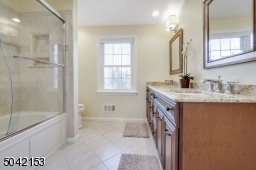 Hall Bath with Jetted Tub and Double Sinks