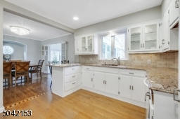 Open to Dining Room and Family Room