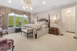 The large master bedroom features two fully finished walk-in closets with beautiful vistas of the gorgeous backyard setting.