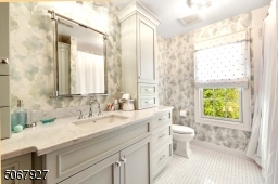 This bathroom is the result of a completely gutting and replacing the entire bathroom with high-end finishes.