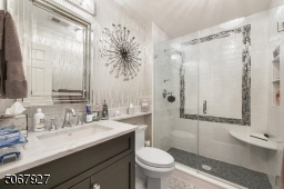 This bathroom is also the result of a completely gutting and replacing the entire bathroom with high-end finishes.