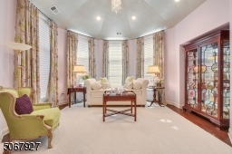 The upstairs sitting room with cathedral ceiling is simply gorgeous.