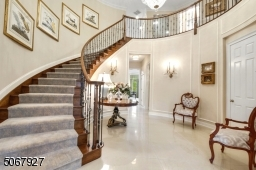 New custom hardwood staircase, paint and lighting highlight the spacious foyer.