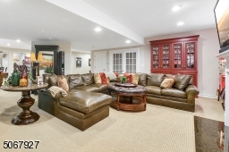 Seen at the far side of this room are French doors leading to large private office (not shown in pictures), that also may be perfect for your next media room.