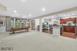 The lower level is largely above grade lined with gorgeous window treatments and new carpeting and provides access to patio, backyard and walking path