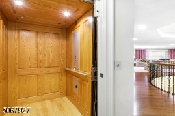 High-end elevator provides access to all levels and not shown, found across from the elevator is an exceedingly large finished storage area.