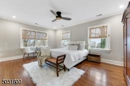 Bedroom 2 is en-suite with hardwood floors, base moldings, crown moldings