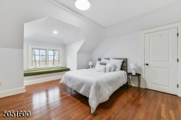 Bedroom 6 / Sitting Room  with baseboard molding, vaulted ceiling, walk-in closet, additional storage