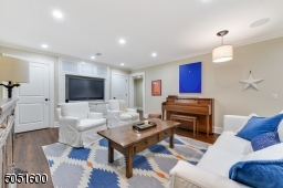 Recreation Room / Media Center featuring recessed lights, barrel style pendant lights, built-in speakers, premium vinyl floor, built-in TV flanked by two built-in closets