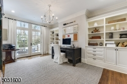 Home Office featuring hardwood floors, built-in cabinets with French Doors to show-stopping bluestone patio