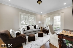 The Leisure  Room or second Home Office features 3 walls with windows and additional access to the rear grounds.