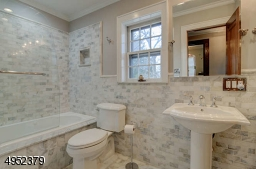 Jetted tub, marble tile, double sinks