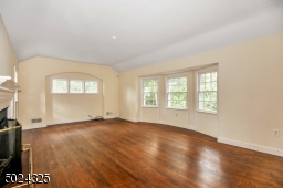 Gleaming wood floors, bay window and fireplace offer a great canvas to create a fabulous entertaining space.