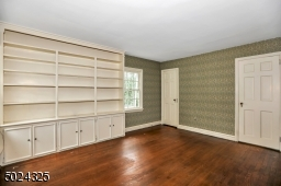 Wood floors, beautiful custom bookcase, walk in cedar closet and Jack and Jill bathroom are all the elements needed for a comfortable and spacious bedroom.