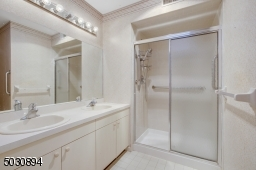 Double sink vanity, stall shower