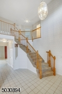 Two story, tile floor, coat closet, curved staircase