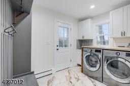 Two Laundry rooms: A fully equipped first floor laundry/mudroom and an option for a second floor laundry room. Access to large deck & backyard from the kitchen