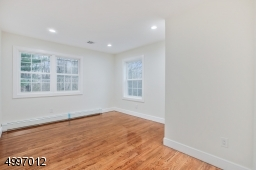 All Second-floor bedrooms have hardwood floors, new windows & new recessed lighting. All bedroom closets are designed with shelving.