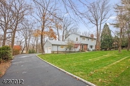 Located in a preferred New Providence neighborhood, close to top rated schools & shopping. Home set approximately on .44 acre.  Access to NYC transportation & major highways. Newly Paved Driveway.