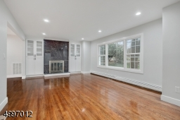 Stunning living space.Architecturally pleasing details, hardwood floors, custom moldings, recessed lighting throughout, brand new windows and doors