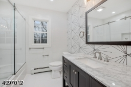 Full Second floor large designer bath with a shower over bathtub, enclosed with a frameless glass sliding shower door, decorative wall porcelain tile & custom linen closet. Located right next to optional second laundry room