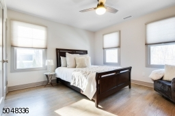 Features hardwood floors, deep baseboard moldings, 2 exposures of windows, ceiling fan and double fitted closet