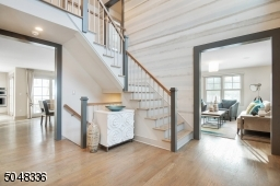 The double-height Foyer features a modern staircase and is a completely open concept.